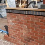 Handmade bricks give old feel to new building