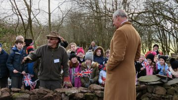 HRH by the dry stone wall